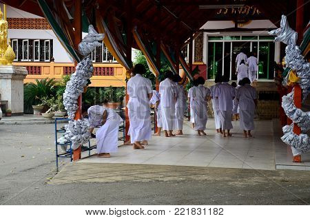 Thai people and children ordain as a nun and Brahmin for practice the dharma at Wat Amphawan on November 7, 2015 in Sing Buri, Thailand