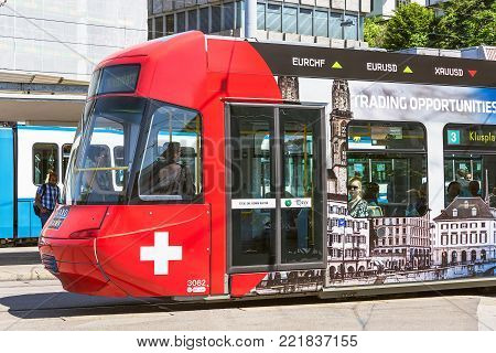 Zurich, Switzerland - 3 June, 2015: a tram passing along a city street. Trams make an important contribution to public transport in Zurich, they have been a consistent part of the cityscape since the 1880s, electrified from the 1890s.