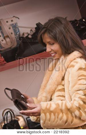 Woman Buying Purse