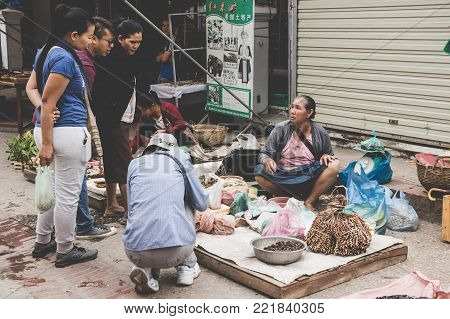 Luang Prabang, Laos - November 13, 2017: Buddhist Alms Giving Ceremony In The Morning. The Tradition