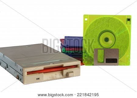 Floppy disk drive and diskettes on white background, old technology and legacy industrial computer equipment