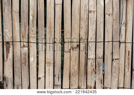Wooden bamboo fence background for barrier and enclosing an area