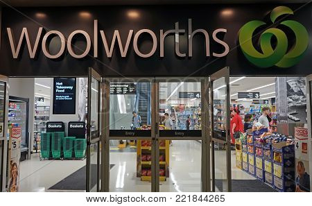 Sydney, Australia - November 03, 2017: Unidentified people shop at Woolworths Supermarket in Sydney. Woolworths is Australian grocery store chain, along with Coles together accounting for about 80% of Australian market.