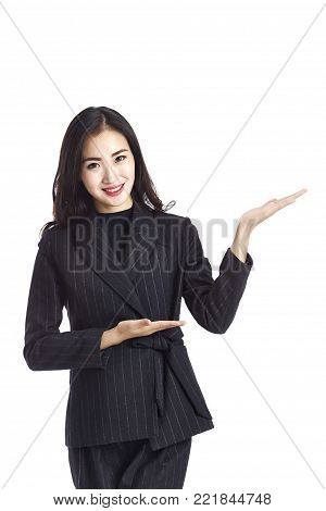 studio shot of a young and beautiful asian business woman making an introduction, isolated on white background.