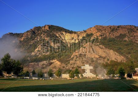 The mountain of Kozhuh (in Bulgarian Kozhuh planina) seen from the valley of Rupite and the public park created in it. The place is famous for Baba Vanga who lived there and its hot springs.