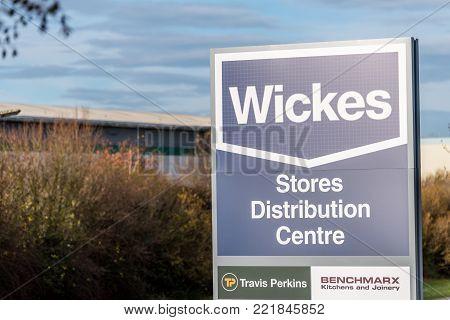 Northampton UK December 09, 2017: Wickes Builders Merchant logo sign in Brackmills Industrial Estate.