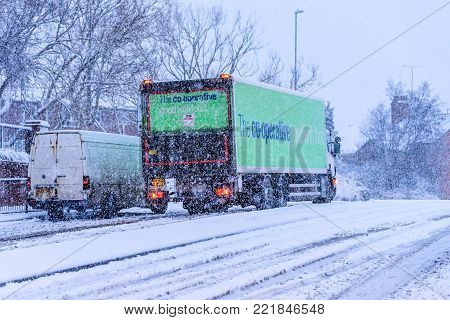 Northampton UK December 10, 2017: Cooperative Delivery Truck slips on snowy British road.