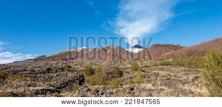The mount Etna Volcano with snow and smoke in Sicily, Catania, Italy (Sicilia, Italia) Europe
