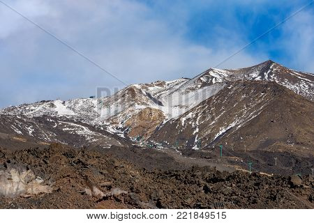 The mount Etna Volcano with snow in winter. Sicily island, Catania, Italy (Sicilia, Italia), Europe
