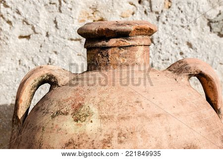 Detail of an old Terracotta Amphora with two handles, in the small village of Marzamemi, Syracuse (Siracusa) - Sicily island, Italy