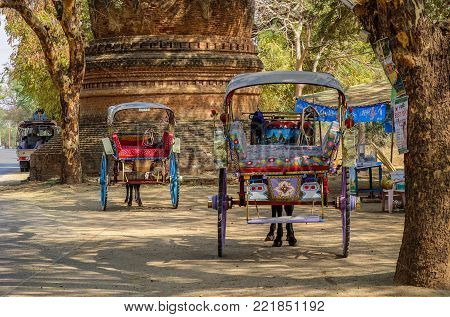 Bagan, Myanmar - Feb 17, 2016. Horse carts waiting at ancient Buddhist temple in Bagan, Myanmar. Bagan in central Burma is one of the world greatest archeological sites.