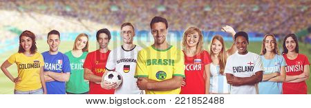 Soccer fan from Brazil with supporters from France, Germany, Russia and other countries