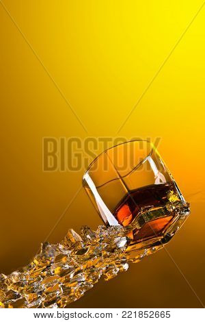Glass of Whiskey with ice.View from the bottom .Copy spase for your text .
