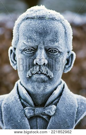 RIBE, DENMARK  - JANUARY 7 2018: Bust with hoarfrost of the world's famous Danish photographer and journalist, Jaob A (1849 - 1914). Riis. Born in Ribe and later emigrated to America. The bust performed by artist Gudrun Steen-Andersen and placed in Ribe,