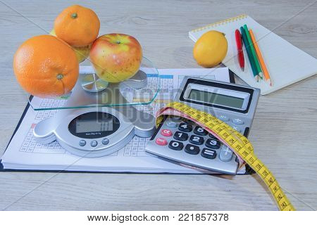 Concept of diet. Low-calorie fruit diet. Diet for weight loss. Measuring tape and fruits on the table. Vegetarian diet for weight loss. Fruit diet. Low-fat diet
