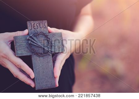 Woman Hands Holding A Holy Cross, Crown Of Thorns And Nail.easter And Good Friday Concept.worship Go