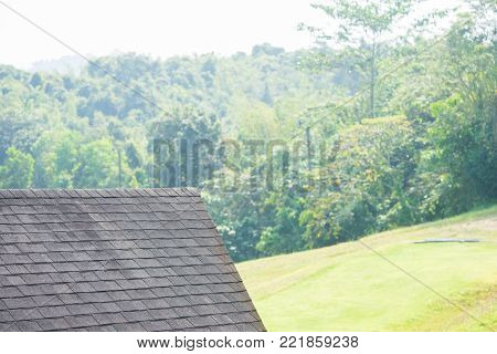 Close up view on Asphalt Roofing Shingles Background. Roof Shingles - Roofing. Bitumen tile roof.