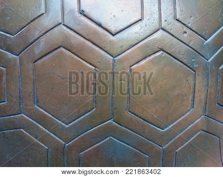 Old Bronze Relief In Buddhist Temple. Highly Decorative Surface Covered With Gexagon Pattern. Shiny