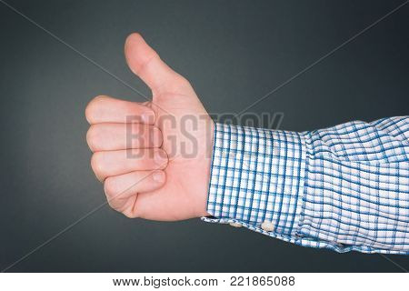 Like and approve hand gesture with thumb up, businessman accepting terms with gesticulation