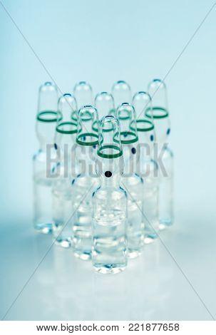 Ten Translucent Ampoules With Liquid Inside