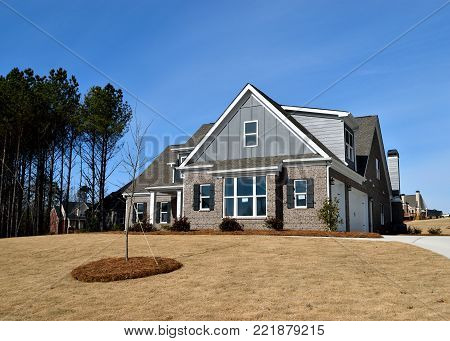 STATHAM, GEORGIA, USA - JANUARY 8, 2018: Home construction is booming at local counties in Georgia. Shown is a new constructed hone on January 8, 2018 in Statham, Georgia.