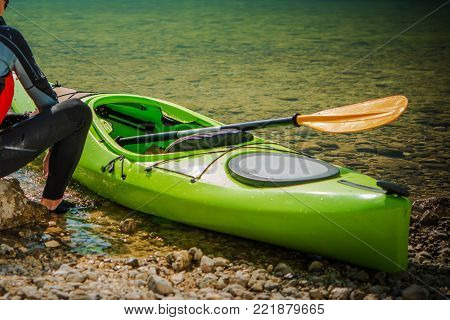 Kayak Touring Recreation. Caucasian Sportsman on the Lake Shore with His Kayak