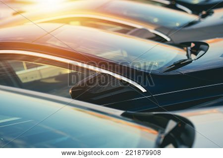 New Car Dealer Vehicles in Stock Closeup Photo. Automotive Industry Theme.