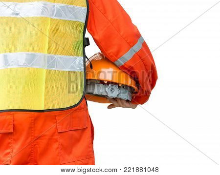 Engineer man in safety uniform holding the helmet isolated on white background with clipping path
