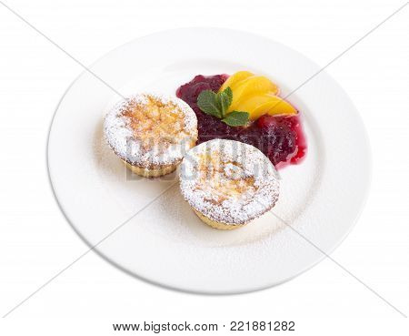 Cheese muffin with cranberry sauce and peaches. Isolated on a white background.
