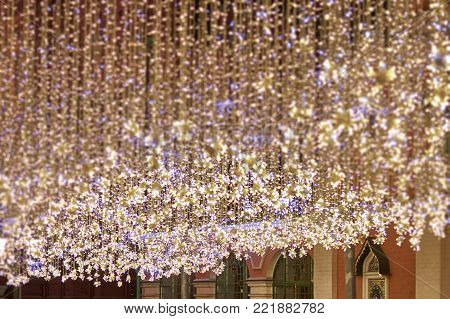 Soft focus christmas garlands with glittering bright background, For use decoration festival and happy new year background. Soft blurred and de-focused.