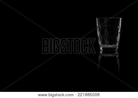 Faceted shot of vodka, tequila and Sambuca on a black background. Place for your text.