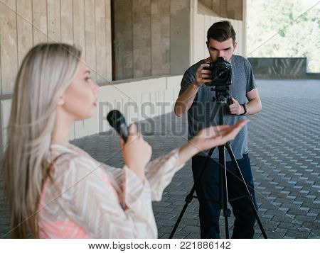 student tv reporter. youth crew filming news story. journalism television broadcast telecommunication press concept