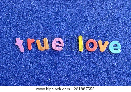 The words true love in colorful letters on a blue background