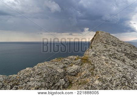 View from the top of Cape Alchak towards the sea. Summer, overcast. Surroundings of Sudak, Crimea.