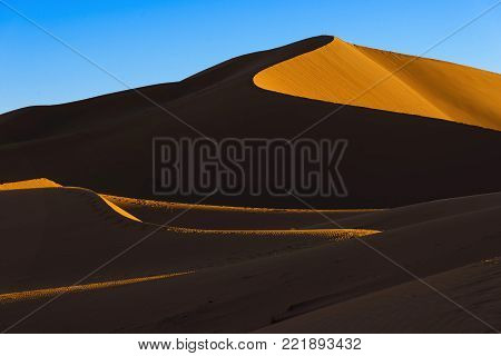 The dunes of Erg Chegaga at sunset. Erg Chegaga (or Chigaga) is one of two major Saharan ergs of the Sahara in Morocco. It is the largest and wildest of Morocco.