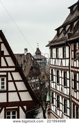 Street in historical city center of old town by Nuremberg, roofs of fachwerk houses in old town Bavaria, Germany