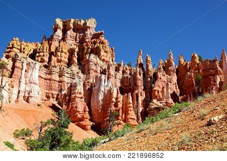 Pink and white striped hoodoo rock formations in Bryce Canyon National Park