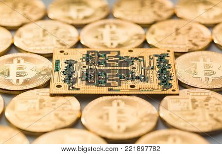 Bitcoins  and golden microchip . Physical bit coins. Digital currency. Cryptocurrency. Golden coins with bitcoin.