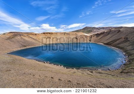 View of Viti crater at krafla caldera in Iceland. Krafla is a caldera of about 10 km in diameter with a 90 km long fissure zone, in the north of Iceland in the Myvatn region