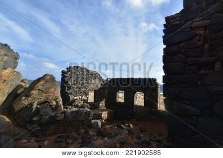 Beautiful photo of the ocean and a gold mill ruin
