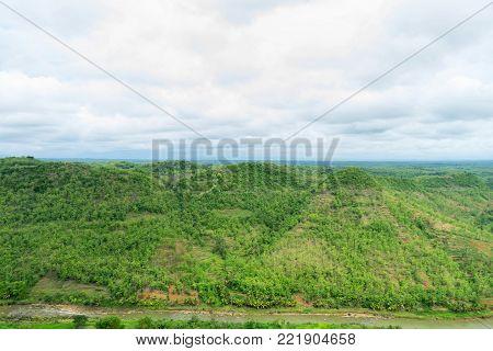 Beautiful landscape mountain hill scene, view from Yogykarta Indonesia. Scenic tourist travel destination location hill and blue sky.