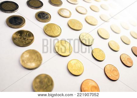 rows of euro currency coins next to eachother