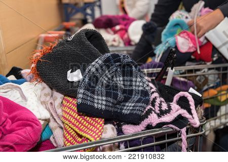 People look for suitable children's clothes at a clothing flea market