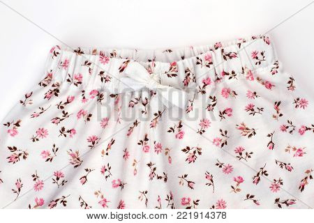 Close up on nightwear bottom. Elastic waistband and white drawstring, fit snugly. Girls would love these flower patterned pants.