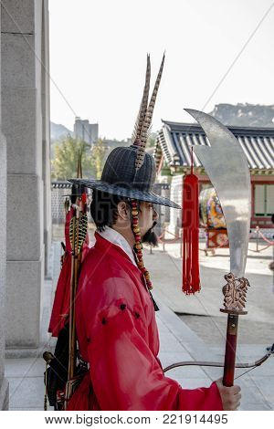 Seoul, South Korea, October 2012: Six times weekly, the Royal Guard-Changing Ceremony in traditional Joseon Dynasty costumes is reenacted at Gyeongbokgung Palace's Gwanghwamun Gate.