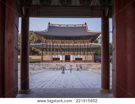 Tourist taking photos on Changdeokgung Palace Complex in Seoul. This is an UNESCO World heritage site.