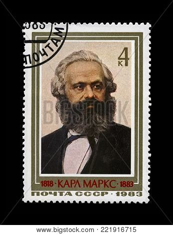 MOSCOW, USSR - CIRCA 1983: canceled postal stamp printed in the USSR shows Karl Marx, famous politician leader, Capital book author, circa 1983. Vintage stamp isolated on black background.