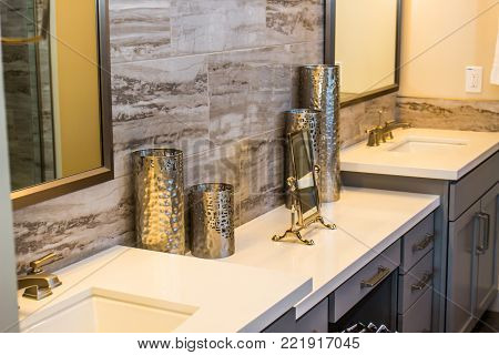 Metal Containers On Counter In Modern Bathroom
