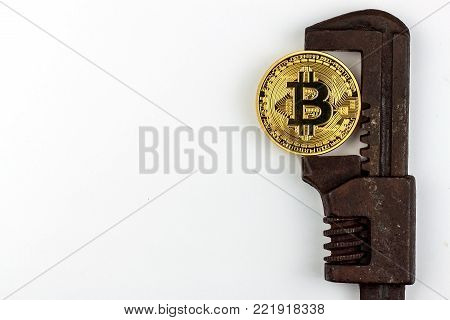 Bitcoin in the clamp. Risk of economic crisis. The fall of the currency. On a white background.