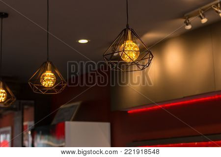 Decorative antique edison style filament light bulbs hanging.